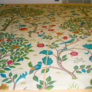 Laying out the William Morris fabric in the process of making the curtains in the previous photograph.