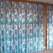 Double hand-pleated headings on a curtain which spans a whole wall. The pleat detail can be seen in the previous photograph (press left arrow to view).