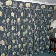 Full length curtains with a separate pelmet above.