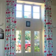Four-metre long triple hand-pleated curtains, lined with blackout liner for insulation (because these windows may not be double-glazed under listed building regulations).