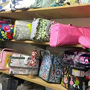 Knitting bags, sewing cases and all kinds of accoutrements at Victoria Fabrics.