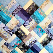 "A ""Jelly-Roll"" quilt made from just one jelly-roll by Betty Hebditch from Victoria Fabrics."