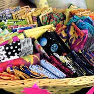 "A basket of ""Fat Quarters"" from Victoria Fabrics."